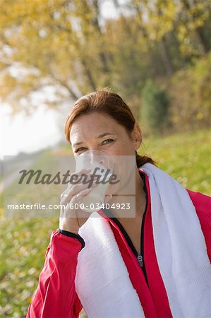 Portrait of Woman Drinking Milk Stock Photo - Premium Royalty-Free, Image code: 600-03404923
