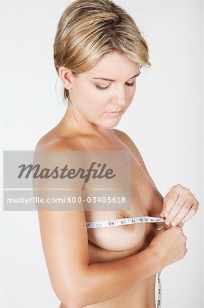 Woman Measuring Breasts Stock Photo - Premium Royalty-Free, Image code: 600-03405618