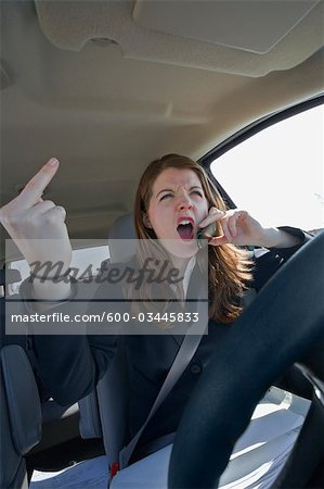 Angry Driver Making Obscene Gesture Stock Photo - Premium Royalty-Free, Image code: 600-03445833