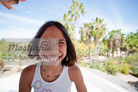 Smiling Girl, Baja, Mexico Stock Photo - Premium Royalty-Free, Image code: 600-03446103