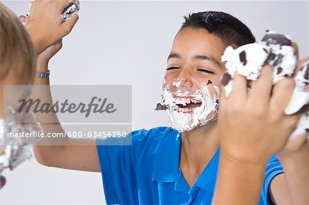 Boys Having a Food Fight Stock Photo - Premium Royalty-Free, Image code: 600-03456250