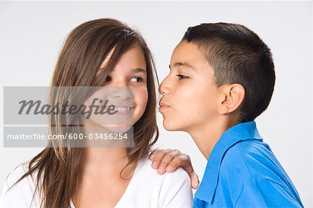 Girl and Boy Kissing Stock Photo - Premium Royalty-Free, Image code: 600-03456254