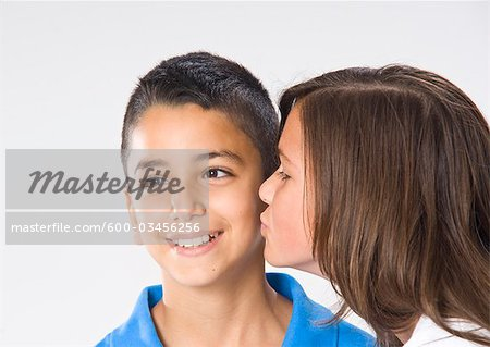 Girl and Boy Kissing Stock Photo - Premium Royalty-Free, Image code: 600-03456256
