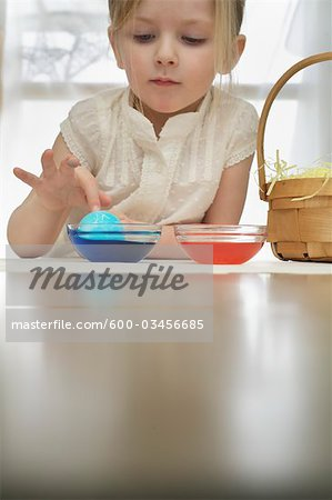 Little Girl Colouring Easter Eggs Stock Photo - Premium Royalty-Free, Image code: 600-03456685