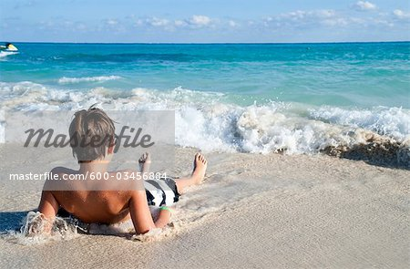 Boy by Surf, Playa del Carmen, Yucatan Peninsula, Mexico Stock Photo - Premium Royalty-Free, Image code: 600-03456884