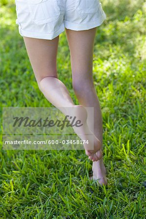 Woman Walking in the Grass, Miami Beach, Dade County, Florida, USA Stock Photo - Premium Royalty-Free, Image code: 600-03458174