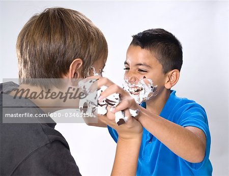 Boys Having a Food Fight Stock Photo - Premium Royalty-Free, Image code: 600-03463158