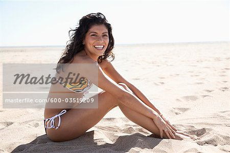 Portrait of Woman Sitting on Beach, Zuma Beach, California, USA Stock Photo - Premium Royalty-Free, Image code: 600-03519209