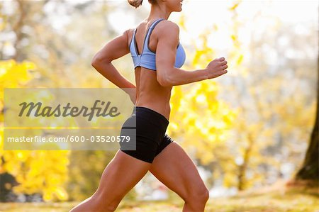Woman Running in the Park, Seattle, Washington, USA Stock Photo - Premium Royalty-Free, Image code: 600-03520579