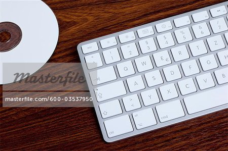 Computer Keyboard and DVD Stock Photo - Premium Royalty-Free, Image code: 600-03537950