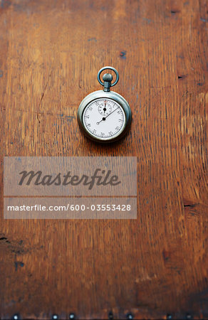 Close-up of Stopwatch on Wooden Surface Stock Photo - Premium Royalty-Free, Image code: 600-03553428