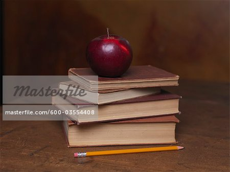 Stack of Old Books With Apple and Pencil Stock Photo - Premium Royalty-Free, Image code: 600-03554408
