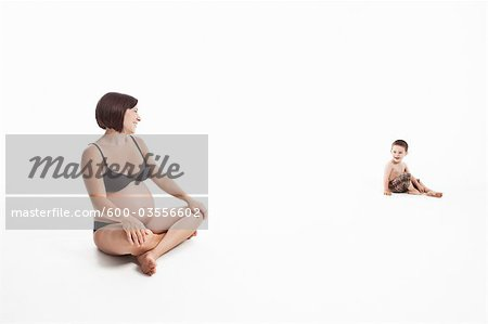 Studio Shot of Pregnant Mother and Son Stock Photo - Premium Royalty-Free, Image code: 600-03556602