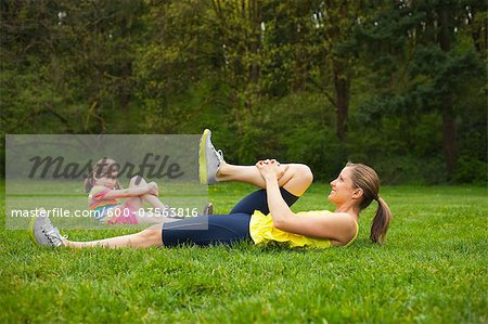 Mother and Young Daughter Exercising in the Park, Portland, Oregon, USA Stock Photo - Premium Royalty-Free, Image code: 600-03563816