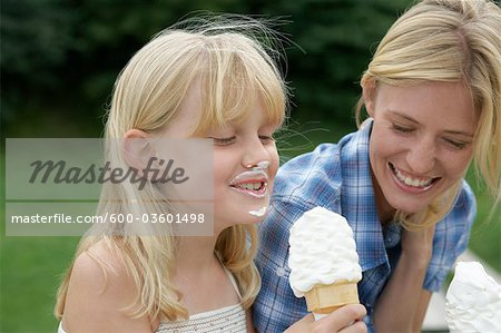 Mother and Daughter Eating Ice Cream Cones Stock Photo - Premium Royalty-Free, Image code: 600-03601498