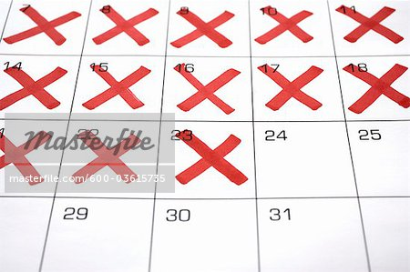 Calendar with X's up to the 24th Stock Photo - Premium Royalty-Free, Image code: 600-03615735