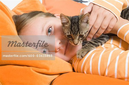 Little Girl Holding Kitten, Dusseldorf, North Rhine-Westphalia, Germany Stock Photo - Premium Royalty-Free, Image code: 600-03615853