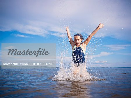 Girl Playing, Lake Wanapitei, Sudbury, Ontario, Canada Stock Photo - Premium Royalty-Free, Image code: 600-03621296