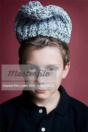 Portrait of Boy Wearing Hat Stock Photo - Premium Royalty-Free, Image code: 600-03623013