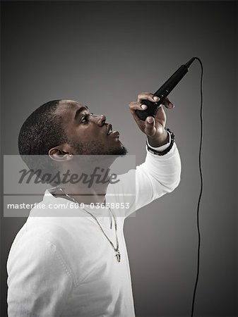 Young Man Singing Stock Photo - Premium Royalty-Free, Image code: 600-03638853