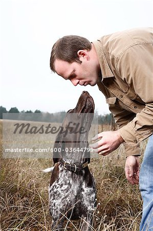 Dog Giving Owner a Kiss, Houston, Texas, USA Stock Photo - Premium Royalty-Free, Image code: 600-03644799