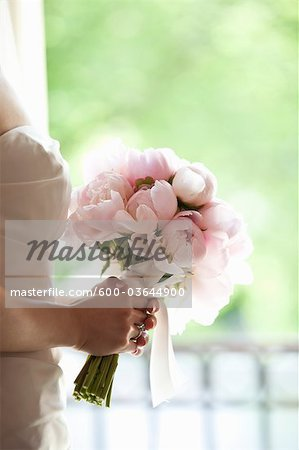 Bride holding Bouquet Stock Photo - Premium Royalty-Free, Image code: 600-03644900