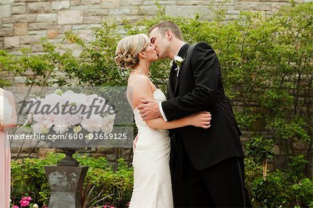 Bride and Groom Kissing Stock Photo - Premium Royalty-Free, Image code: 600-03659125