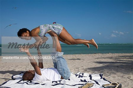 Couple Playing on the Beach, Florida, USA Stock Photo - Premium Royalty-Free, Image code: 600-03682200