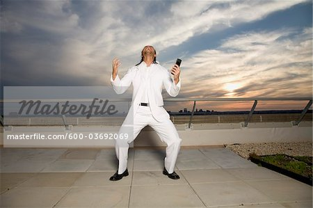Man Screaming on Rooftop Stock Photo - Premium Royalty-Free, Image code: 600-03692069