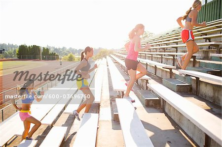 Teenagers Running up Bleachers at Race Track, Lake Oswego, Oregon, USA Stock Photo - Premium Royalty-Free, Image code: 600-03696760