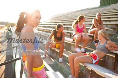 Teenagers on Bleachers by Race Track, Lake Oswego, Oregon, USA Stock Photo - Premium Royalty-Free, Image code: 600-03696765