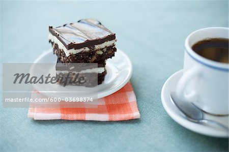 Gluten-free Nanaimo Bars and a Cup of Coffee, Vancouver, British Columbia, Canada Stock Photo - Premium Royalty-Free, Image code: 600-03698374