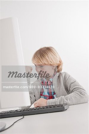 Teenager using Computer Stock Photo - Premium Royalty-Free, Image code: 600-03734630