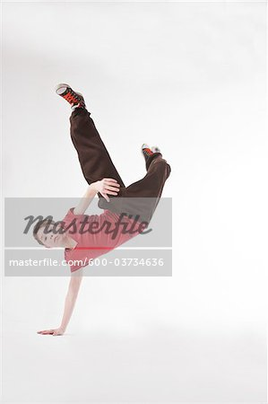Teenager doing Handstand Stock Photo - Premium Royalty-Free, Image code: 600-03734636