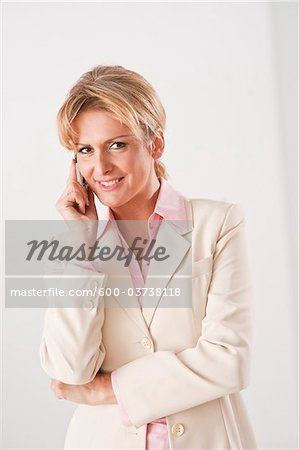Businesswoman Using Cellular Telephone Stock Photo - Premium Royalty-Free, Image code: 600-03738118