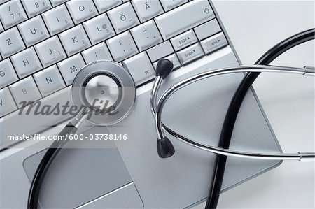 Stethoscope and Laptop Computer Stock Photo - Premium Royalty-Free, Image code: 600-03738146