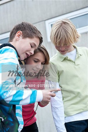 Teenagers Looking at MP3 Player, Mannheim, Baden-Wurttemberg, Germany Stock Photo - Premium Royalty-Free, Image code: 600-03738180