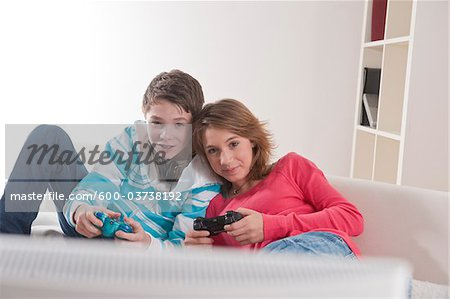 Teenage Couple Playing Video Games, Mannheim, Baden-Wurttemberg, Germany Stock Photo - Premium Royalty-Free, Image code: 600-03738192