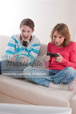 Teenagers Playing Video Games, Mannheim, Baden-Wurttemberg, Germany Stock Photo - Premium Royalty-Free, Image code: 600-03738194