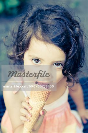 Girl Eating Ice Cream Cone Stock Photo - Premium Royalty-Free, Image code: 600-03738450