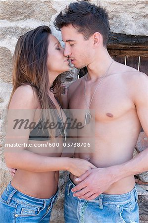 Couple Kissing Stock Photo - Premium Royalty-Free, Image code: 600-03738706