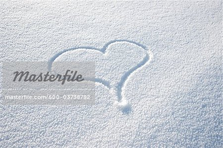 Heart Shape in Snow Stock Photo - Premium Royalty-Free, Image code: 600-03738782