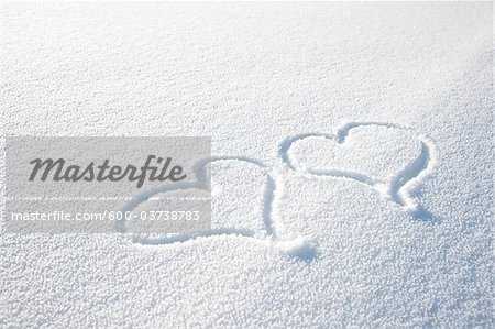 Heart Shapes in Snow Stock Photo - Premium Royalty-Free, Image code: 600-03738783