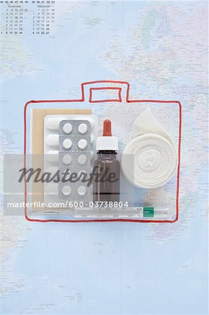 First Aid Travel Kit and Map Stock Photo - Premium Royalty-Free, Image code: 600-03738804