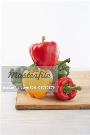 Peppers on Cutting Board Stock Photo - Premium Royalty-Free, Image code: 600-03762579