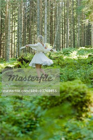 Woman Dancing in Forest, Altenmarkt in Pongau, Salzburg, Austria