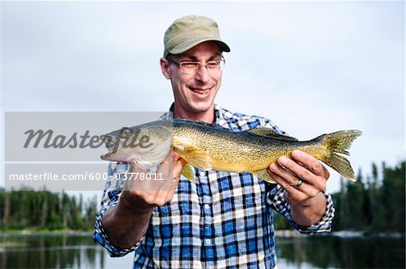 Man Fishing, Otter Lake, Missinipe, Saskatchewan, Canada Stock Photo - Premium Royalty-Free, Image code: 600-03778011