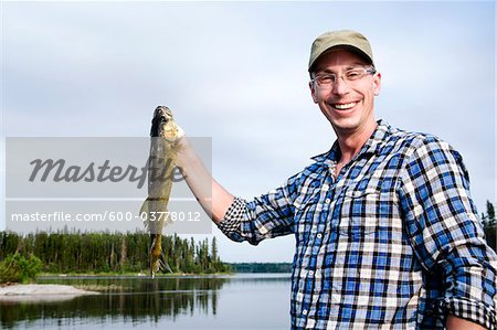 Man Fishing, Otter Lake, Missinipe, Saskatchewan, Canada Stock Photo - Premium Royalty-Free, Image code: 600-03778012