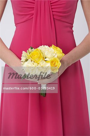 Close-up of Bridesmaid holding Bouquet Stock Photo - Premium Royalty-Free, Image code: 600-03783419