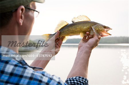 Man Fishing, Missinipe, Otter Lake, Saskatchewan, Canada Stock Photo - Premium Royalty-Free, Image code: 600-03787592